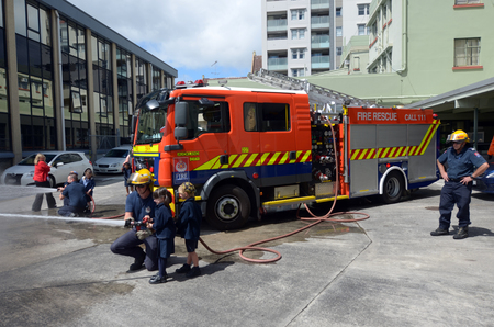 demonstrator: AUCKLAND  - OCT 27 2015:Fire Safety Education day in Auckland City Fire Station, New Zealand.Each year over 20,000 fires are attended by New Zealand Fire Service, including nearly 5,000 house fires. Editorial