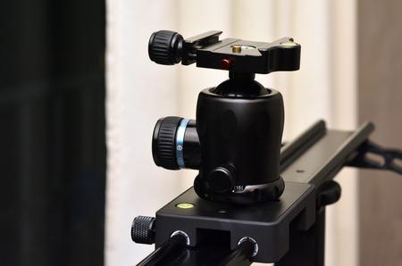 cinematographer: Tripod ball head mounted on linear camera slider.