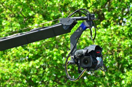 jib: Professional video camera on JIb crane outdoors. Stock Photo