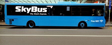 bought: AUCKLAND - NOV 02 2015:Auckland Airport to City transfer SkyBus service.Auckland Airbus has been bought out by the owners of Melbournes Skybus in a major international acquisition announced recently.