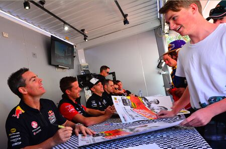 celeb: AUCKLAND - NOV 05 2015:V8 Supercars champion driver Craig Lowndes L sign autographs for Motorsport fans in Auckland, New Zealand.