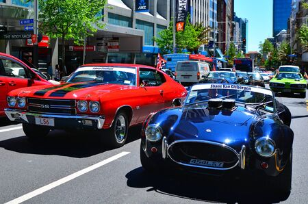 v8: AUCKLAND - NOV 05 2015:US classic muscle cars pared in Auckland, New Zealand.Its A large V8 engine car fitted in a 2-door of family-style mid-size or full-size car designed for 4-5 passengers.