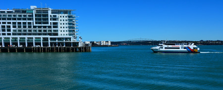 public company: AUCKLAND,  NZL - NOV 05 2015:Fullers MV Quick Cat ferry sail near Princes Wharf. On December 12, 2013, Hilton again became a public company in its second IPO to raise an estimated 2.35 billion. Editorial