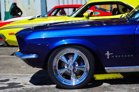 restoring: AUCKLAND,  NZL - NOV 05 2015:Ford Mustangs in a public US muscle cars V8 car show. The 1965 Mustang won the Tiffany Gold Medal for excellence in American design, the first automobile ever to do so. Editorial