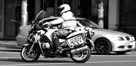 motorcycle police officer: AUCKLAND,  NZL - AUG 01 2015:New Zealand officer rides motorbike. With over 11,000 staff New Zealand police is the largest law enforcement agency in New Zealand.