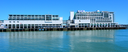 new ipo: AUCKLAND,  NZL - NOV 05 2015:Farry pass by Hilton in Auckland waterfront, New Zealand. On December 12, 2013, Hilton again became a public company in its second IPO to raise an estimated 2.35 billion.