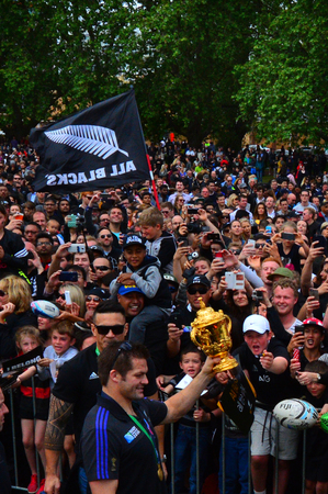 victoria park: AUCKLAND,  NZL - NOV 04 2015:Richie McCaw showing thousands of people the Web Ellis trophy in Victoria Park Auckland, New Zealand.The All Blacks are the holders of the Rugby World Cup in 2011 and 2015. Editorial