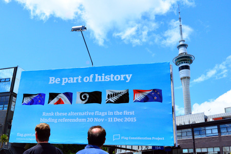 AUCKLAND - NOV 04 2015:New Zealanders look at a billboard with the top 5 alternative new flags.New Zealand Parliament scheduled a two-stage binding referendum that is expected to cost 25.7 million Redakční