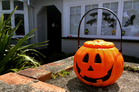 hallows: AUCKLAND - OCT 31 2015:Halloween pumpkin on house front.Halloween is a celebration observed in a number of countries on 31 October, the eve of the Western Christian feast of All Hallows Day. Editorial