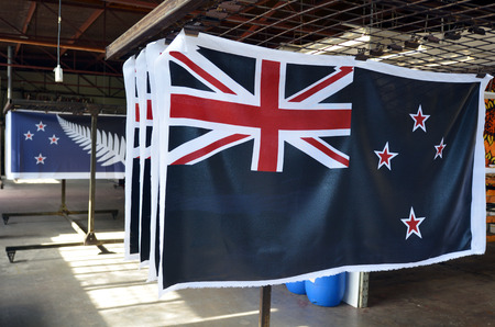 zealand: AUCKLAND - NOV 24 2015:New prints of the National flags of New Zealand (R) dries out. Between 20 Nov and 11 Dec New Zealanders will consider options to their National Flag future