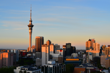 constitutes: AUCKLAND - NOV 06 2015:Auckland New Zealand skyline at sunset.Auckland has a population of 1,454,300, which constitutes 32 percent of the countrys population