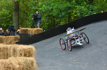 caffeinated: AUCKLAND - NOV 22 2015:Dream trolley race at Red Bull Trolley Grand Prix.Its a novelty downhill race of unpowered vehicles through Auckland Domain sponsored by caffeinated drink manufacturer Red Bull Editorial