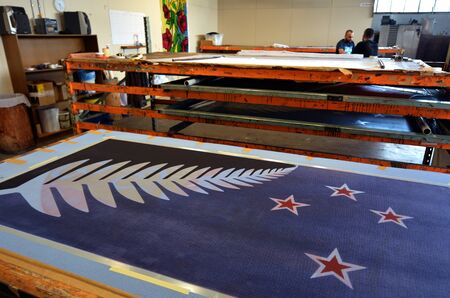 20   24: AUCKLAND - NOV 24 2015: Workers print the Silver Fern (Black, White and Blue) flag. Between 20 Nov and 11 Dec New Zealanders will consider options to their National Flag future.