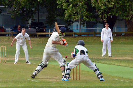 batsman: AUCKLAND - NOV 14 2015:A bowler bowling to a batsman..Its one of New Zealand most popular national sport and the first recorded game took place in Wellington in December 1842.