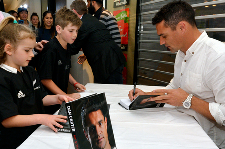 blacks: AUCKLAND - NOV 17 2015:Dan Carter signing copies of his book.He play for the All Blacks and is considered by some experts the greatest ever first-five eighth (fly-half) in the history of the game. Editorial