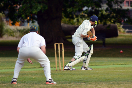 cricket stump: AUCKLAND - NOV 14 2015:Cricket batsman try to blocks the ball. Cricket is played by 120 million players in many countries, making it the worlds 2nd most popular sport.