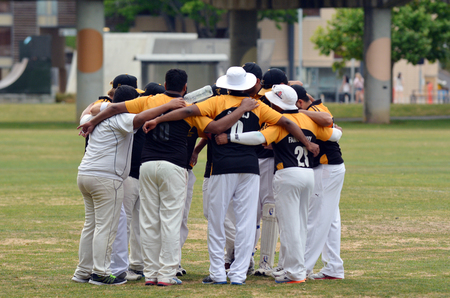 cricket: AUCKLAND - NOV 14 2015:Cricket team pre game huddle in Victoria park Auckland, New Zealand.Its one of New Zealand most popular national sport and the first recorded game took place in Wellington in December 1842. Editorial
