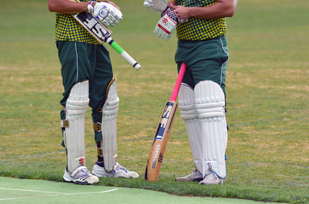 play popular: AUCKLAND - NOV 14 2015:Men play Cricket.Cricket is played by 120 million players in many countries, making it the worlds 2nd most popular sport. Editorial