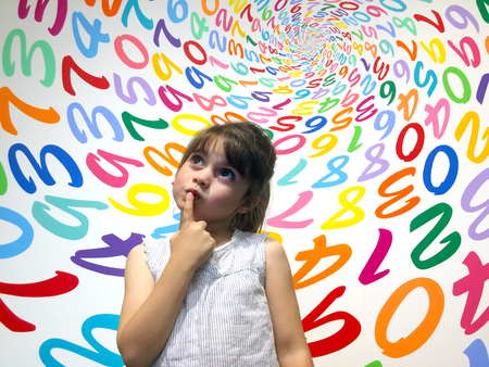 Little girl (age 5-6) do not know how to solve an arithmetic problem. Children education concept