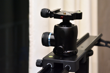 tripod mounted: Tripod ball head mounted on linear camera slider.