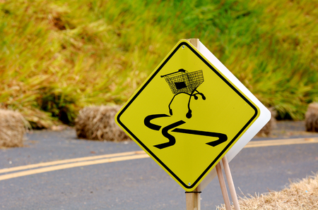 dangerous ideas: Dangerous slippery road sign of shopping trolley on the roadside.Conceptual concept and ideas background with copy space. Stock Photo