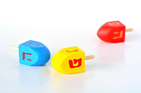 hanukka: Dreidels (sevivons) during the Jewish holiday of Hanukkah. It is a four-sided spinning top, played with during the Jewish holiday of Hanukkah. Holiday concept with copy space