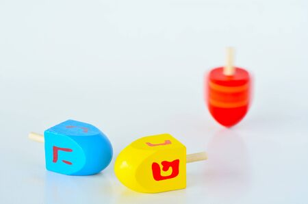 Dreidels (sevivons) during the Jewish holiday of Hanukkah. It is a four-sided spinning top, played with during the Jewish holiday of Hanukkah. Holiday concept with copy space