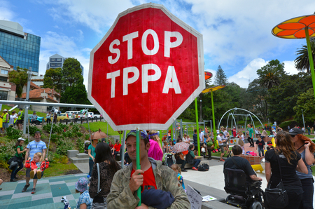 new economy: AUCKLAND - NOV 28 2015:Protestors in Rally against TPPA trade agreement in Auckland.12 nations including New Zealand have been negotiating TTP trade deal, which would cover 40 of the world economy.