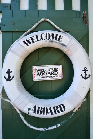 life saving: CHRISTCHURCH - DEC 04 2015:Welcome aboard sign on a life saving wheel of Punting on the Avon river Christchurch.It is an iconic tourist attraction of Christchurch, New Zealand. Editorial