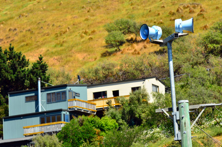 warning system: CHRISTCHURCH,  NZL - DEC 07 2015:Air raid siren in Christchurch New Zealand.Tsunami warning system have been installed along Christchurch coastline after 2011 earthquake killed 185 people