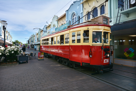 reclaiming: CHRISTCHURCH - DEC 04 2015:Tram pass on New Regent Street. Christchurchs beloved New Regent Street is reclaiming its place as a one of the most popular shopping and visitor destination Editorial