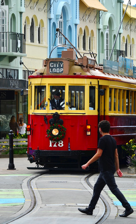 reclaiming: CHRISTCHURCH - DEC 07 2015:Tram pass on New Regent Street. Christchurchs beloved New Regent Street is reclaiming its place as a one of the most popular shopping and visitor destination