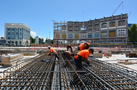 CHRISTCHURCH - DEC 07 2015:Builders builds a new building in Christchurch.Over 1000 buildings in the CBD (Central Business District) were demolished following Christchurch earthquakes