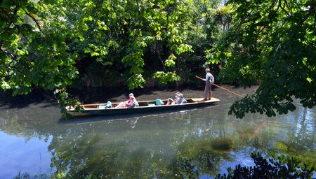 punting: CHRISTCHURCH - DEC 04 2015:People Punting on the Avon river Christchurch.It is an iconic tourist attraction of Christchurch, New Zealand.