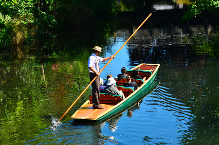 punting: CHRISTCHURCH,  NZL - DEC 08 2015:People Punting on the Avon river Christchurch.It is an iconic tourist attraction of Christchurch, New Zealand.