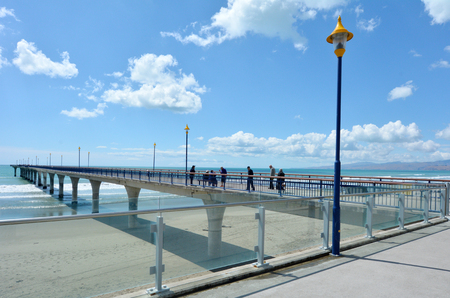 australasia: CHRISTCHURCH - DEC 07 2015:Visitors on New Brighton Pier in Christchurch. The pier is one of Christchurch main tourist attractions, spanning 300 meters long, it is the longest pier in the Australasia
