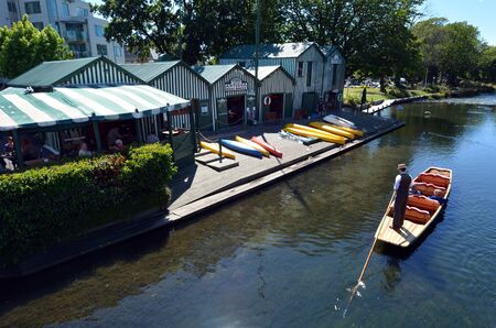 punting: CHRISTCHURCH - DEC 08 2015:Aerial view of People Punting near the Punting boat shed on the Avon river Christchurch.It is an iconic tourist attraction of Christchurch, New Zealand.