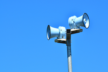 raid: Air raid siren , against blue sky for emergency hazard of: tsunami, war, fire and flood.