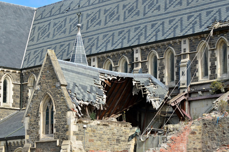 severely: CHRISTCHURCH - DEC 06 2015:ChristChurch Cathedral.The February 2011 Christchurch earthquake destroyed the spire and part of the tower, and severely damaged the structure of the remaining building. Editorial