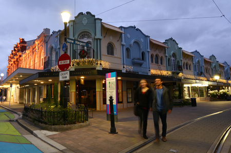 reclaiming: CHRISTCHURCH - DEC 08 2015:Visitors at New Regent Street at night. Christchurchs beloved New Regent Street is reclaiming its place as a one of the most popular shopping and visitor destination Editorial