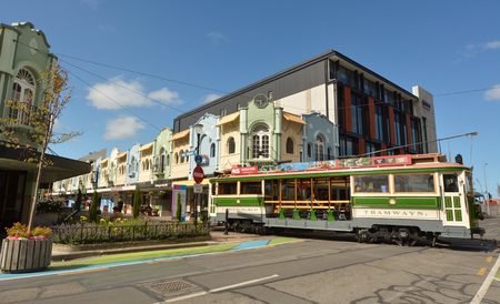 regent: CHRISTCHURCH - DEC 06  2015:Tram pass by New Regent Street. Christchurchs beloved New Regent Street is reclaiming its place as a one of the most popular shopping and visitor destination Editorial