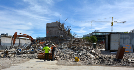 new construction: CHRISTCHURCH - DEC 04 2015:Builders clear a damaged building in Christchurch.Over 1000 buildings in the CBD (Central Business District) were demolished following Christchurch Editorial