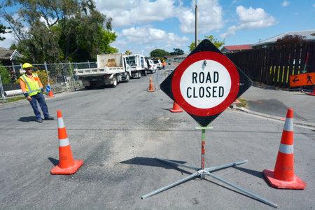 quake: CHRISTCHURCH - DEC 07 2015:Road work in Christchurch.The bill for fixing Christchurchs quake damaged roads and underground pipes estimate is $2 billion (USD)