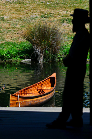 punting: CHRISTCHURCH - DEC 04 2015:Silhouette of a Punting sailor on the Avon river Christchurch.It is an iconic tourist attraction of Christchurch, New Zealand. Editorial