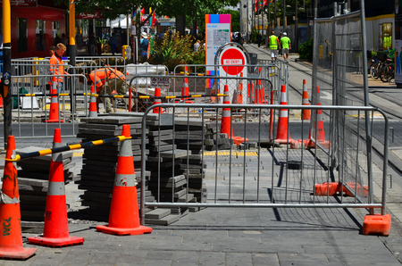 CHRISTCHURCH - DEC 04 2015:Road work in Christchurch.The bill for fixing Christchurchs quake damaged roads and underground pipes estimate is $2 billion (USD) Éditoriale