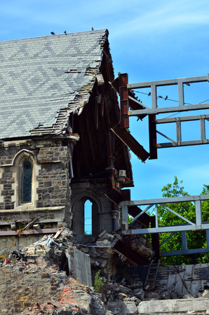 severely: CHRISTCHURCH - DEC 04 2015:Damge on ChristChurch Cathedral.The 2011 Christchurch earthquake destroyed the spire and part of the tower, and severely damaged the structure of the remaining building. Editorial