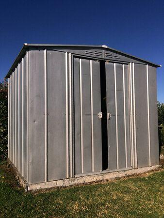 hobby hut: Garden shed in the home garden. Gardening concept Stock Photo