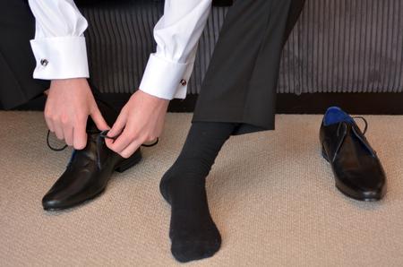 bridegroom: Man (bridegroom) wearing elegant men shoes on his wedding day.
