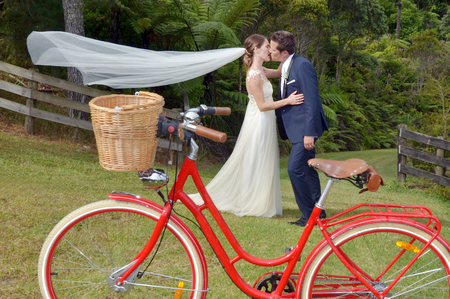 fun day: Husband and wife kiss on their wedding Day outdoors.Concept of wedding, relationship and marriage. copy space