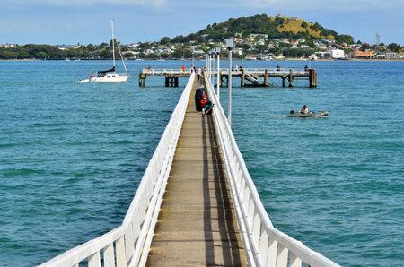 tourist attraction: AUCKLAND - JAN 11 2016:Okahu Pier in Okahu Bay.Its a popular tourist attraction in Auckland, New Zealand. Editorial